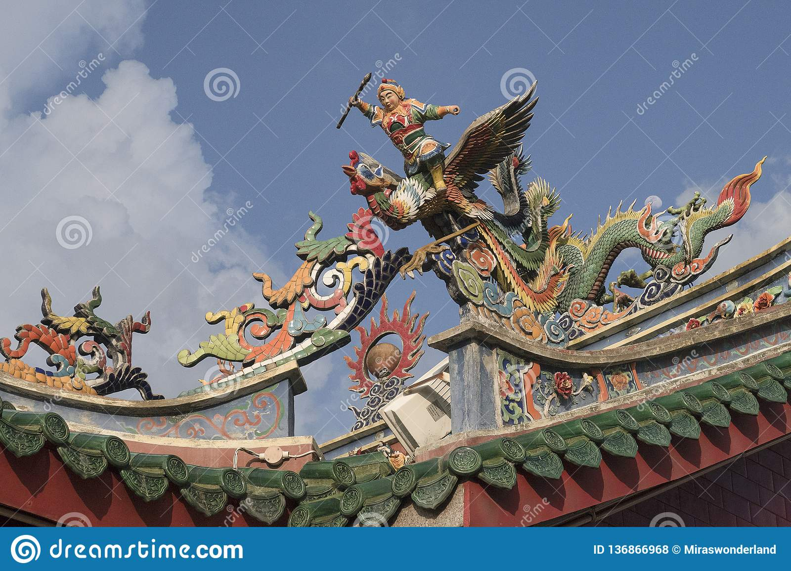 Statues on the roof of a chinese temple in the streets of Kuching of Malaysia
