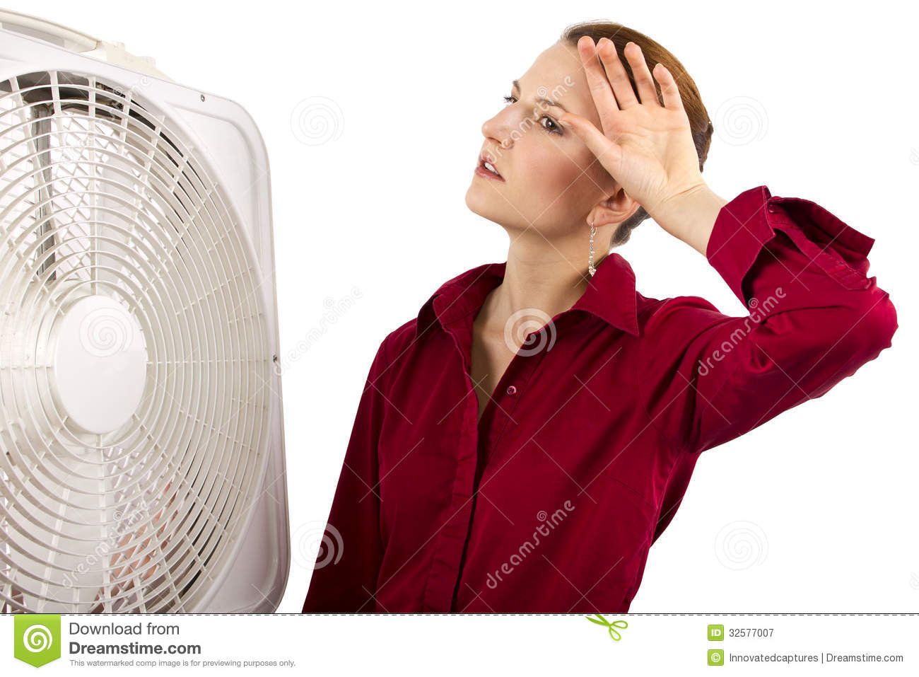 Cooling Off With Fan : Staying cool at work royalty free stock photography