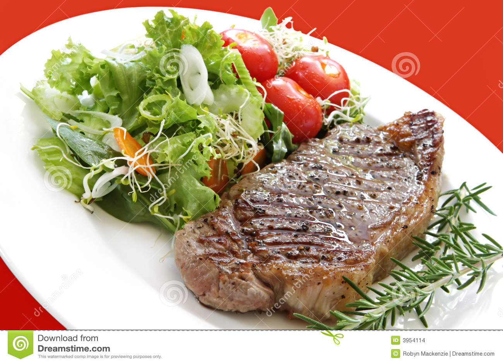 Grilled steak with salad. Porterhouse or New York strip steak, grilled ...