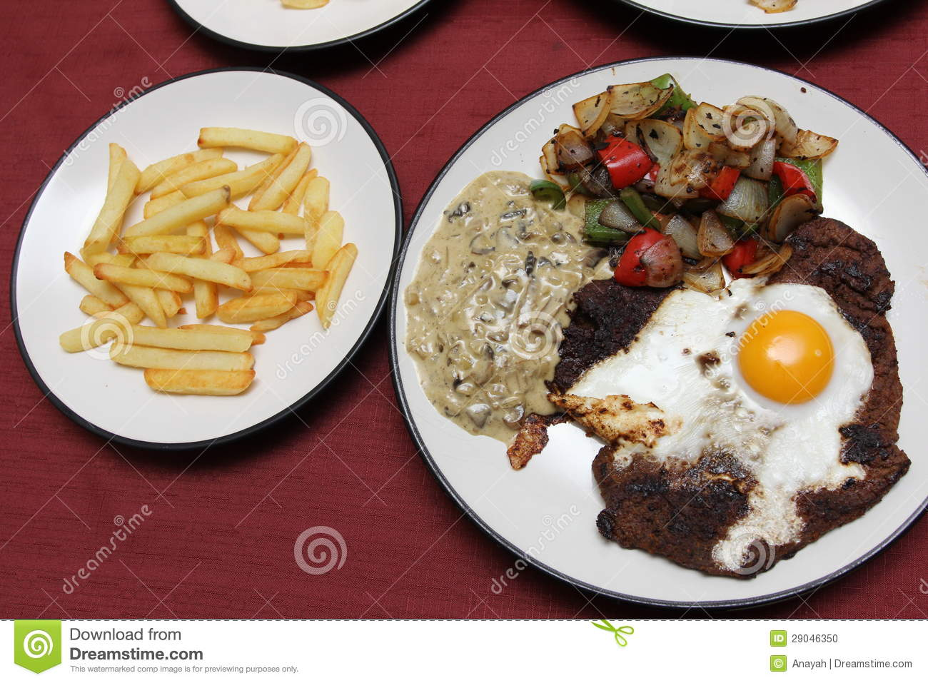 ... fried egg cooked over it, served with mushroom sauce, vegetables and