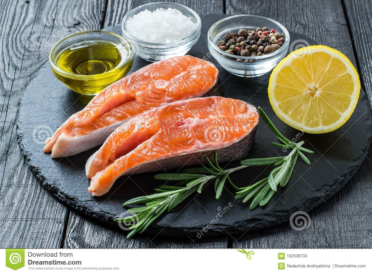Steaks Of Raw Fresh Salmon And Ingredients For Cooking Stock Image
