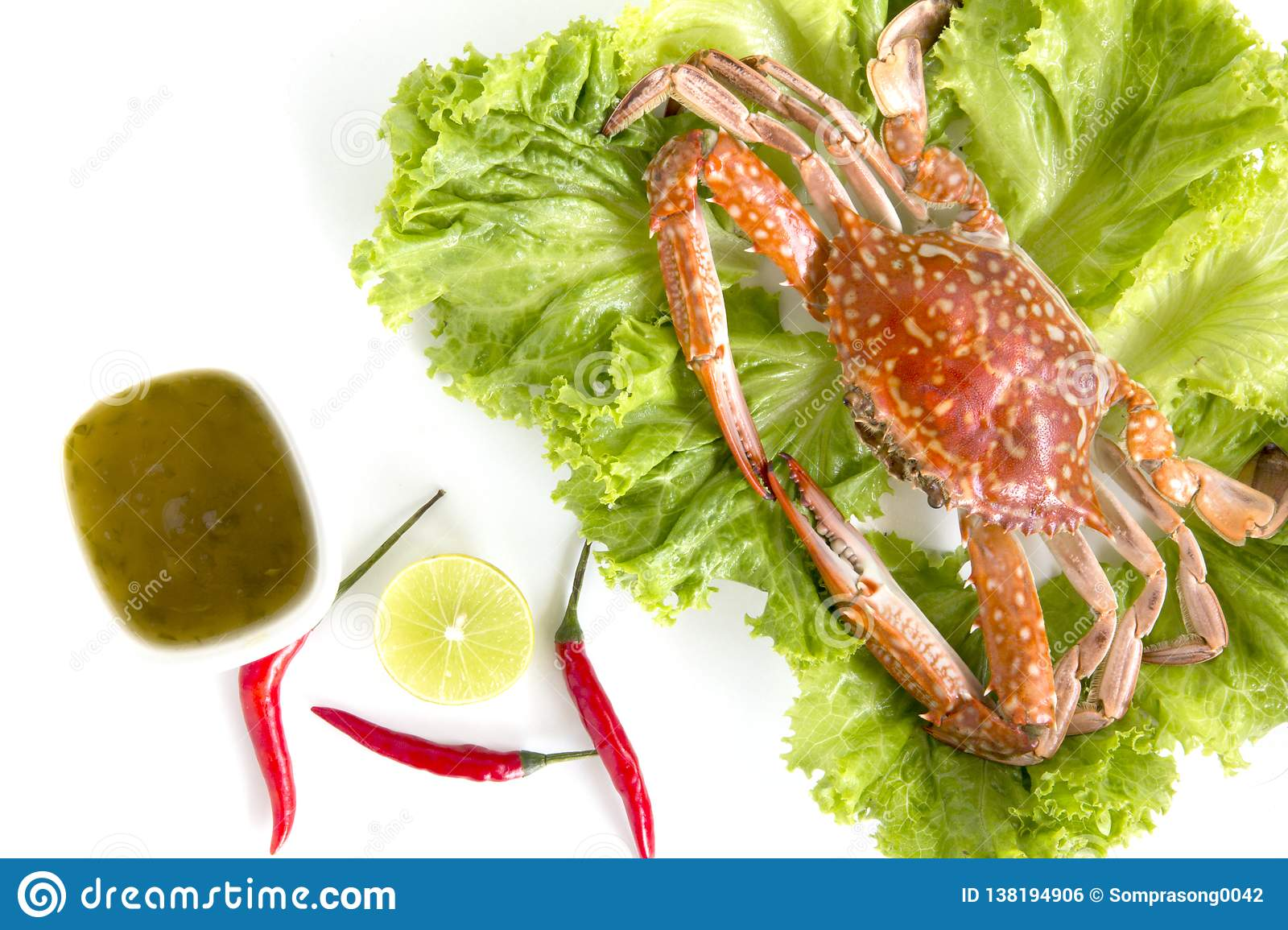 Steamed blue swimming crab, Flower crab, Blue crab Portunus pelagicus and spicy sauce isolated on white background