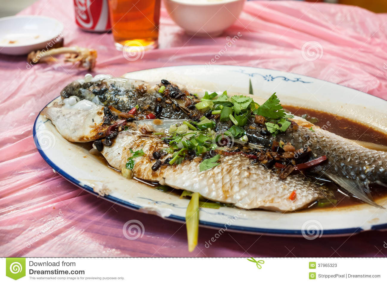 ... . Here, a fresh steamed fish is served with black bean and soy sauce