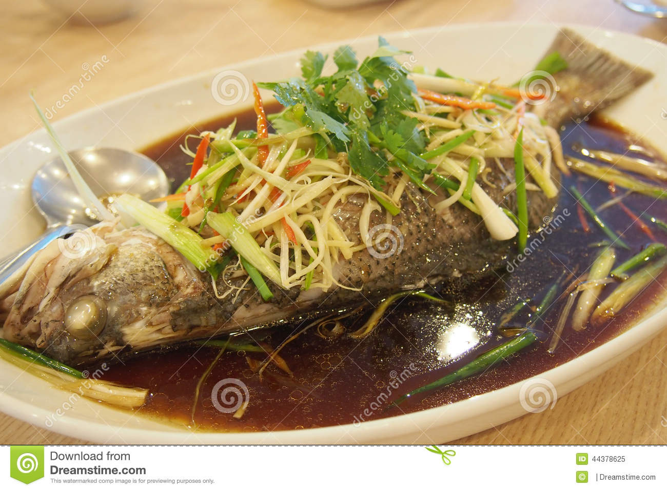 Steamed fish with soya sauce stock photo image 44378625 for Soy sauce fish