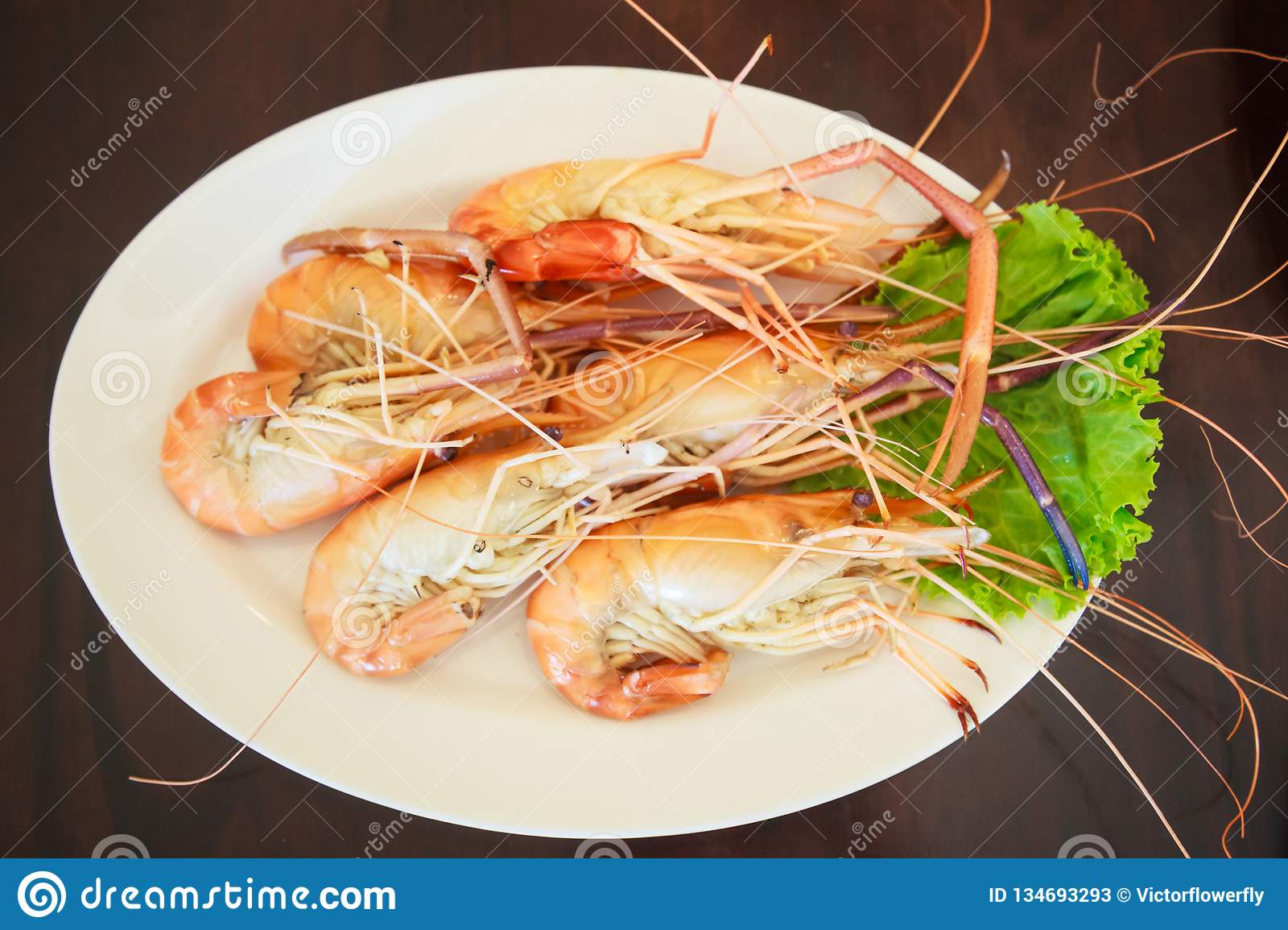 Steamed Seafood from sea market, Fresh Tasty Appetizing Cooked Tiger Prawns on Wooden Table Background. Food, Nutrition, Allergy,
