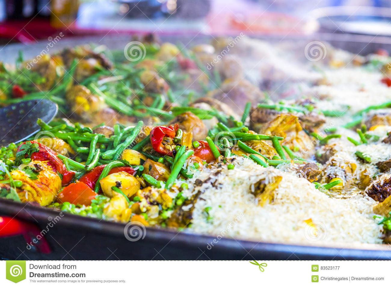 Steaming hot paella, seafood, rice and vegetables in French mark
