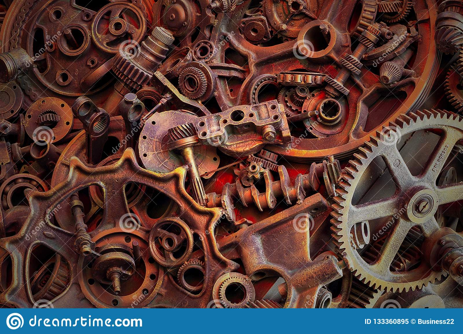 Steampunk background, machine and mechanical parts, large gears and chains from machines and tractors.
