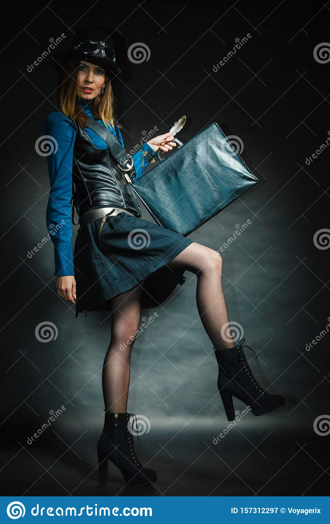 Steampunk girl with retro bag