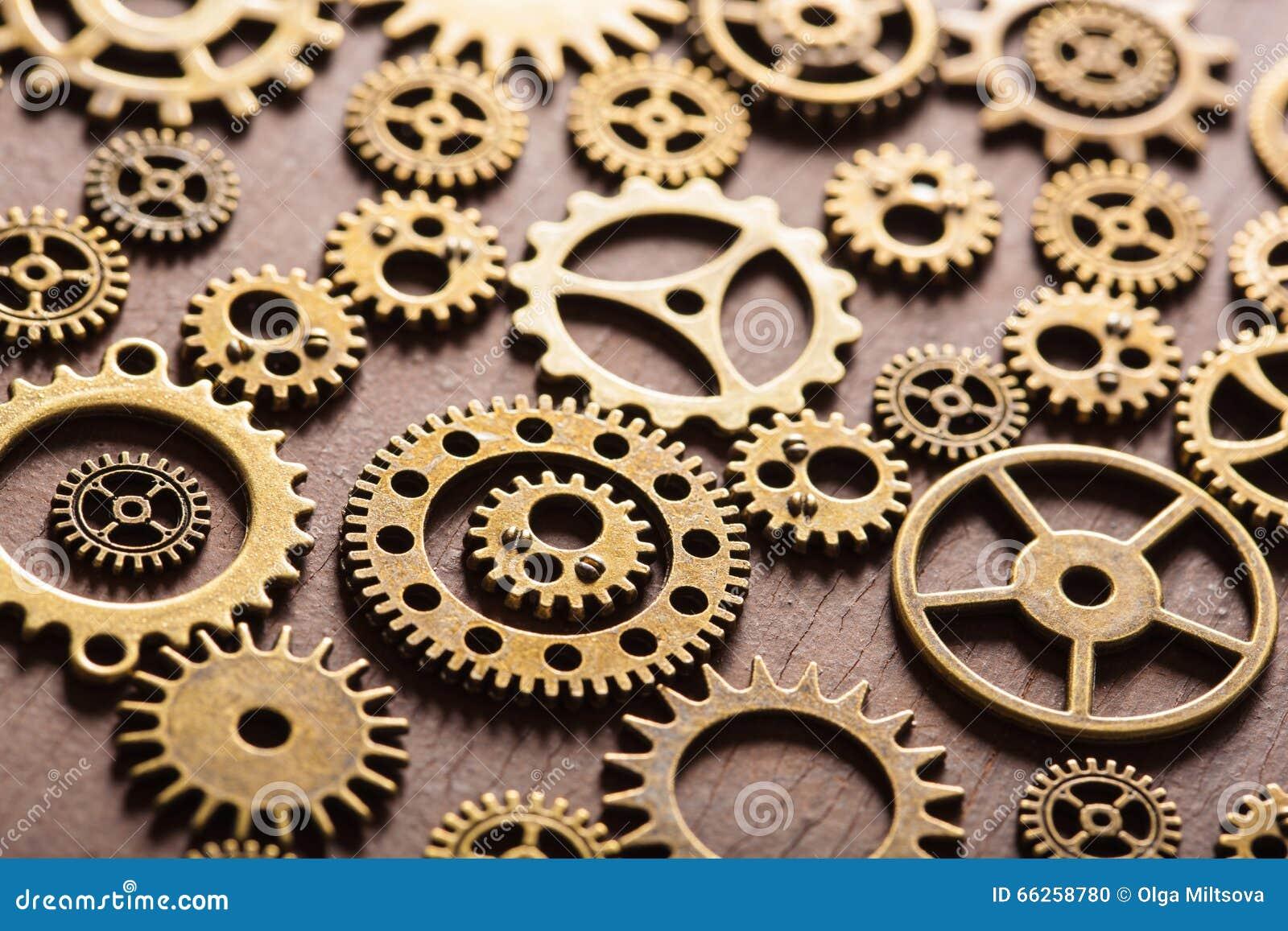 steampunk mechanical cogs gears wheels on wooden background stock