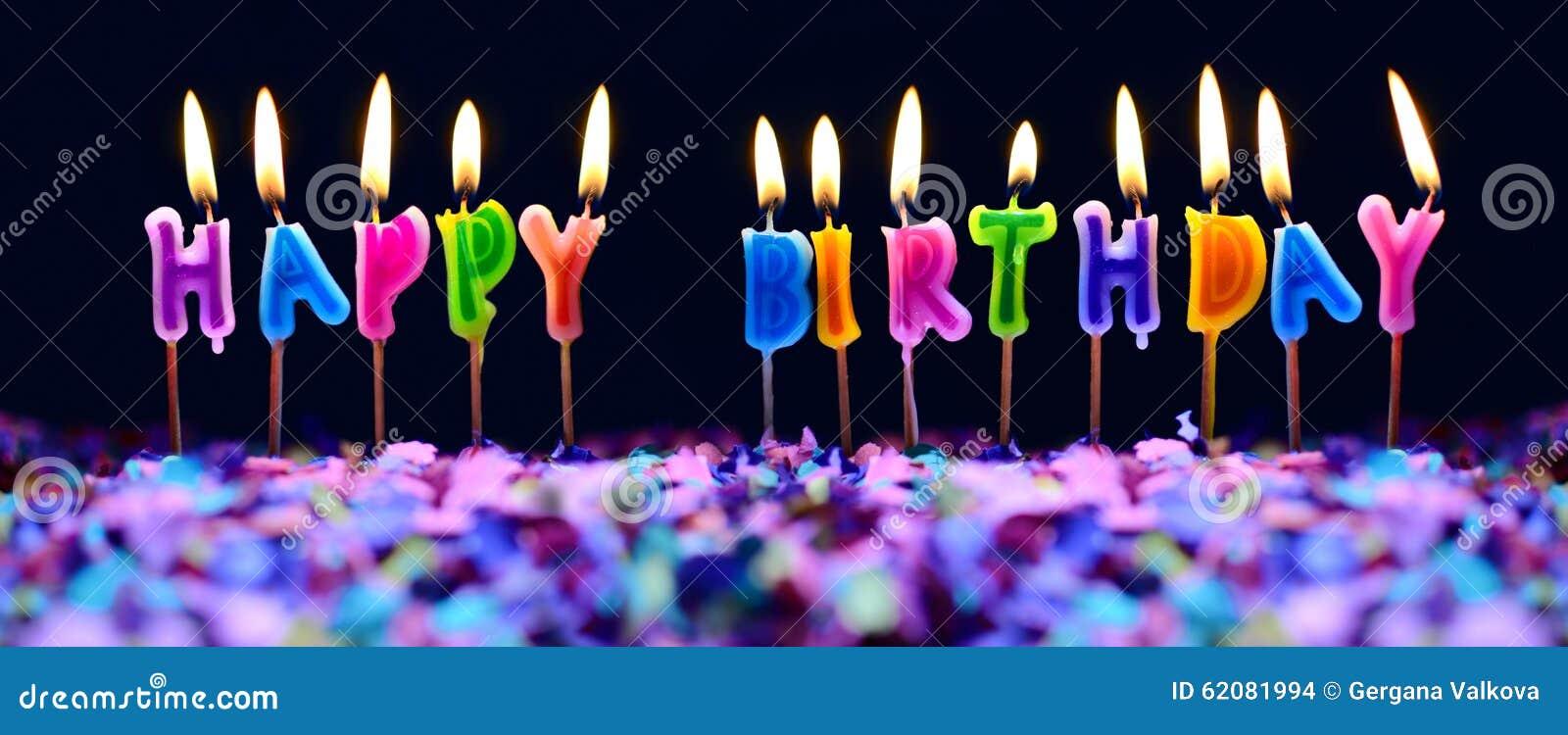 Stearinljus för lycklig födelsedag och isolerade partikonfettier