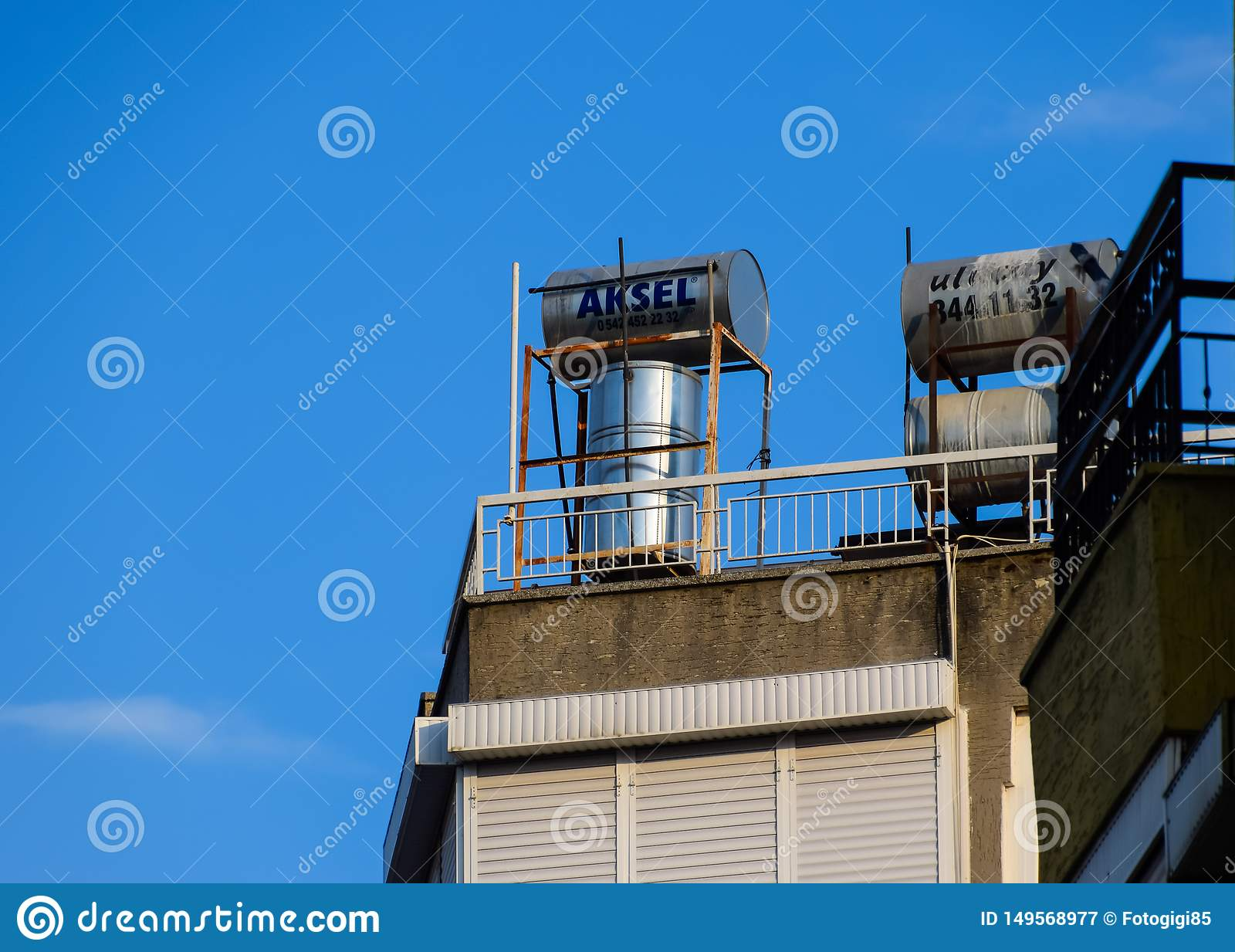 Steel barrels of boilers with water on the roof of a building to heat