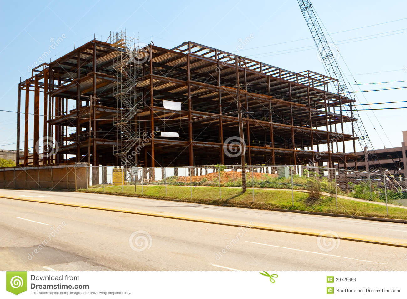 steel frame building construction site in a city
