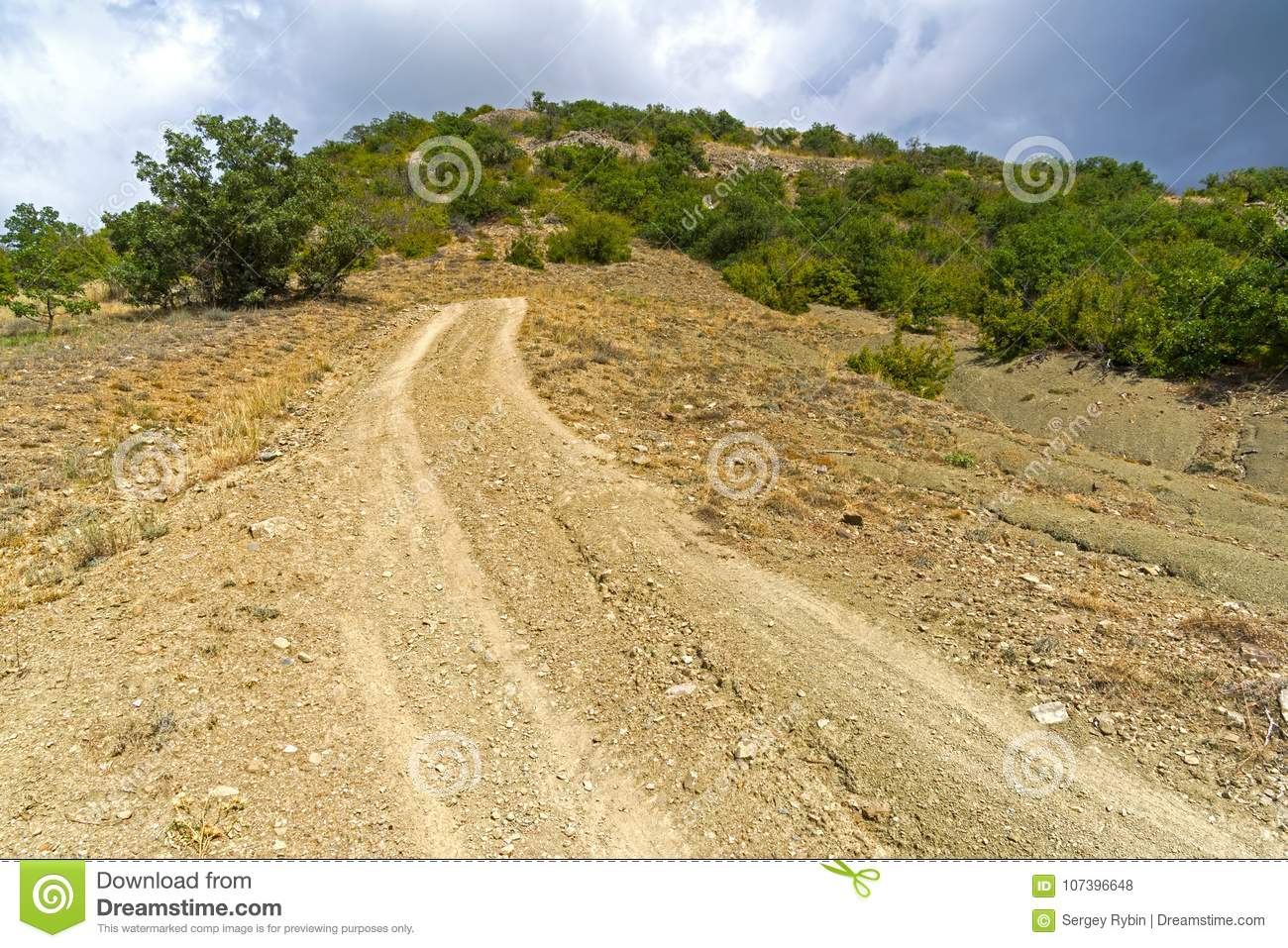 Steep descent on a dirt road.