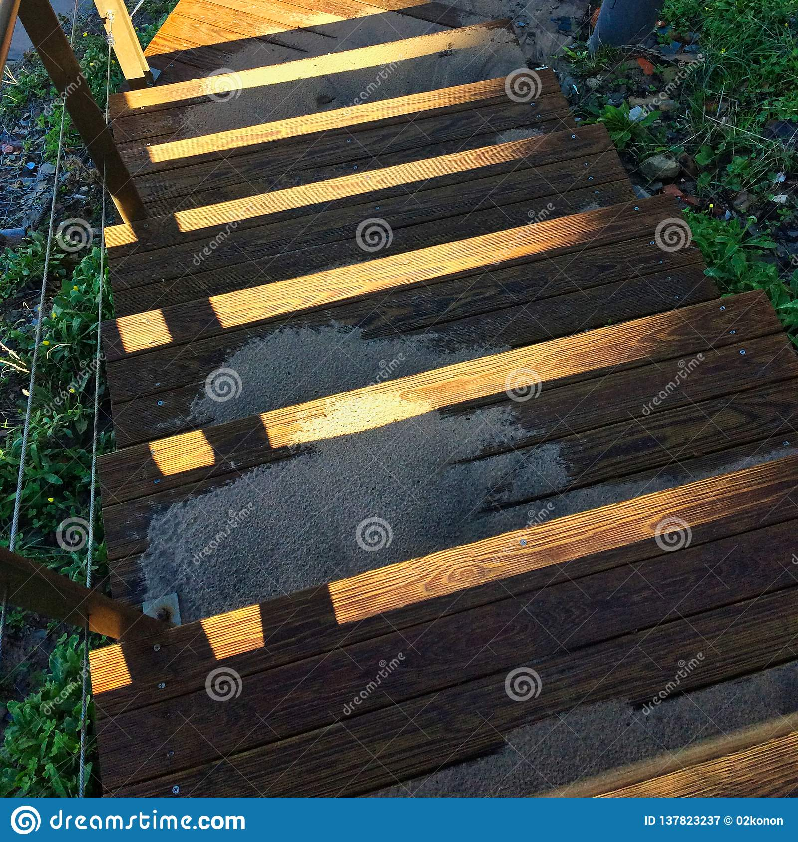 Steep Wooden Staircase Leading Down, Sand Scattered On The