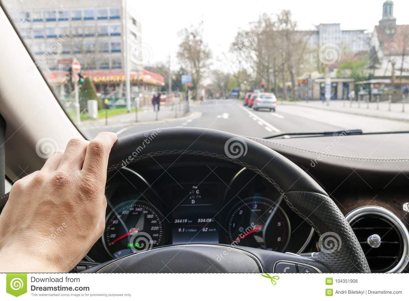 Modern Interieur Wit : Steerind wheel with driver hand on it in modern car interior wit