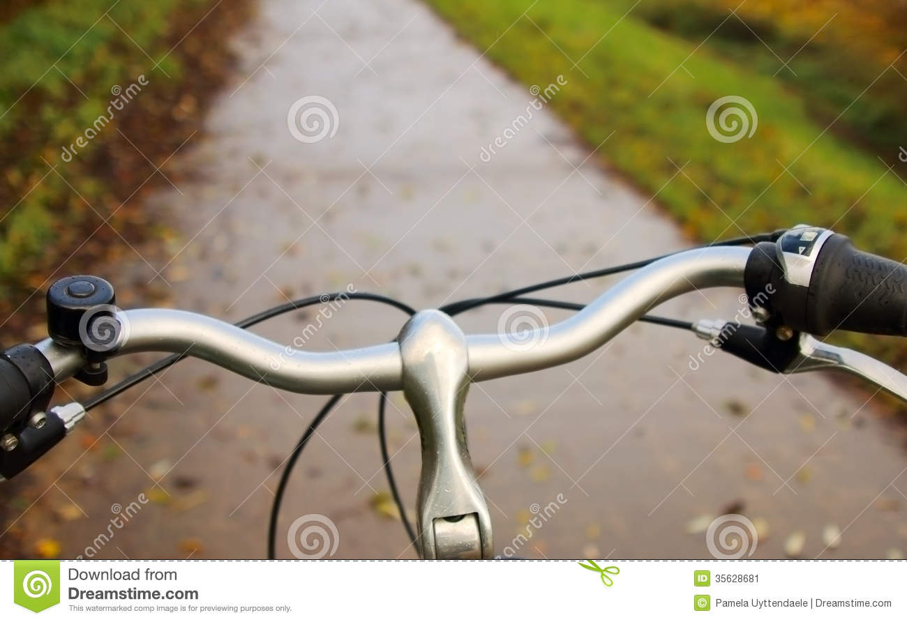 Steering Wheel Of A Bike With The Path In The Background