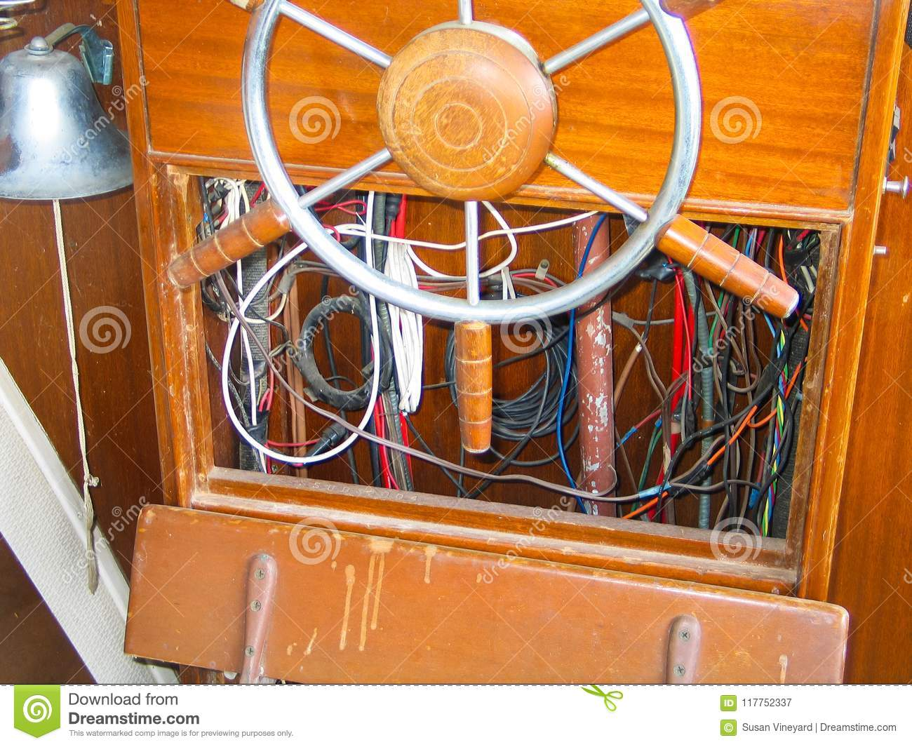 steering wheel and exposed wiring inside helm of old wooden boat Simple Boat Wiring a steering wheel and exposed wiring inside helm of old wooden boat
