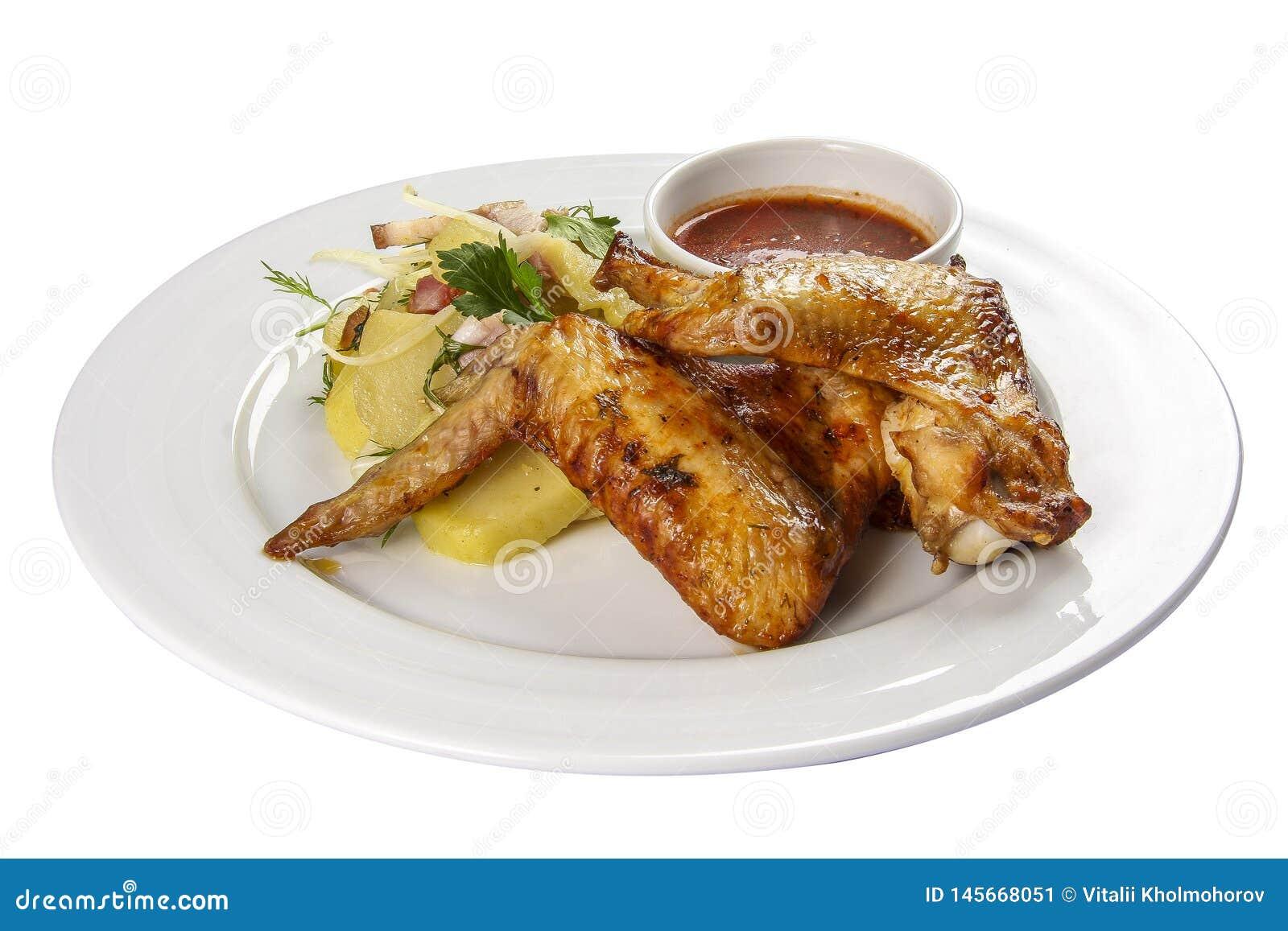 Stekt kycklingvingar med potatisar