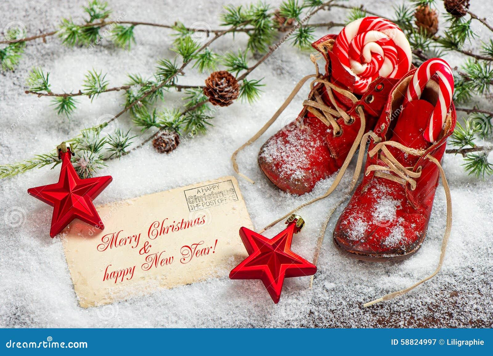 Stelle rosse della decorazione di natale e scarpe di for Immagini cartoline di natale