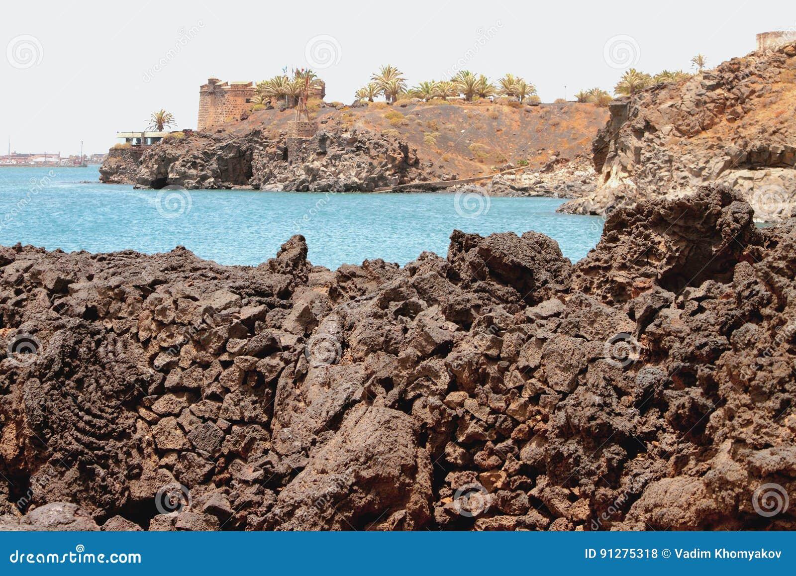 Stelnad lava- och havsgolf Arrecife Lanzarote, Spanien