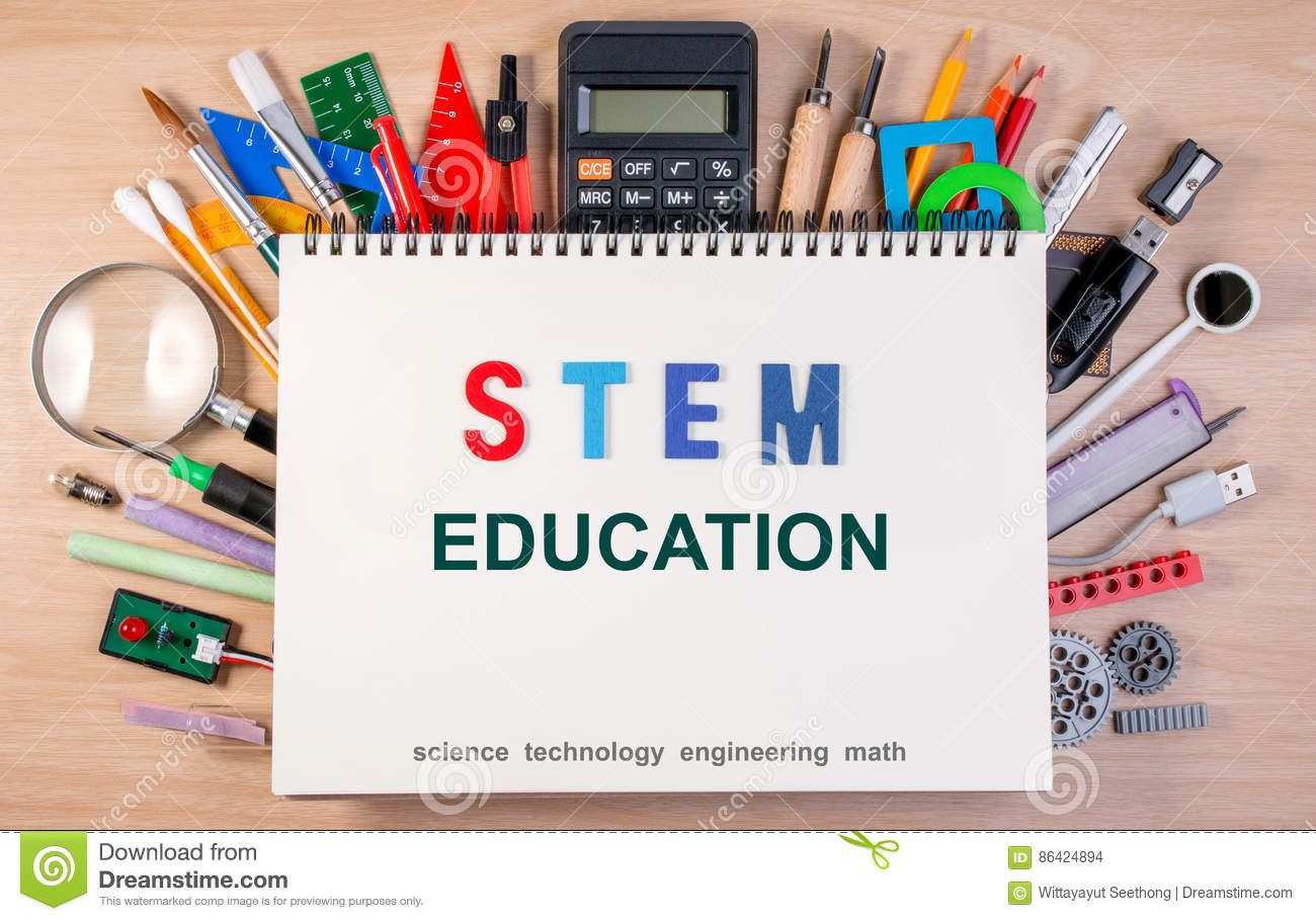 STEM education text on notebook over school supplies or office s