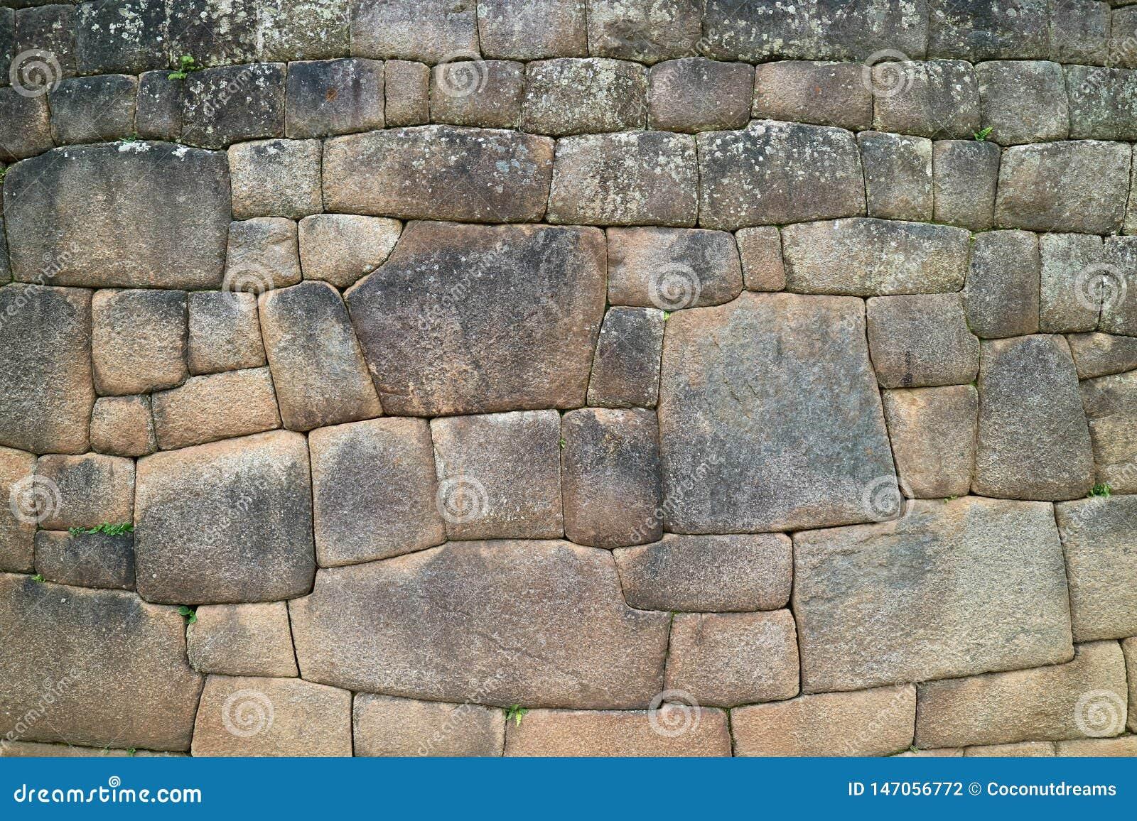 Stena väggen med den unika Inca Stonework Inside Machu Picchu forntida citadellen, Cusco, Urubamba, arkeologisk plats i Peru