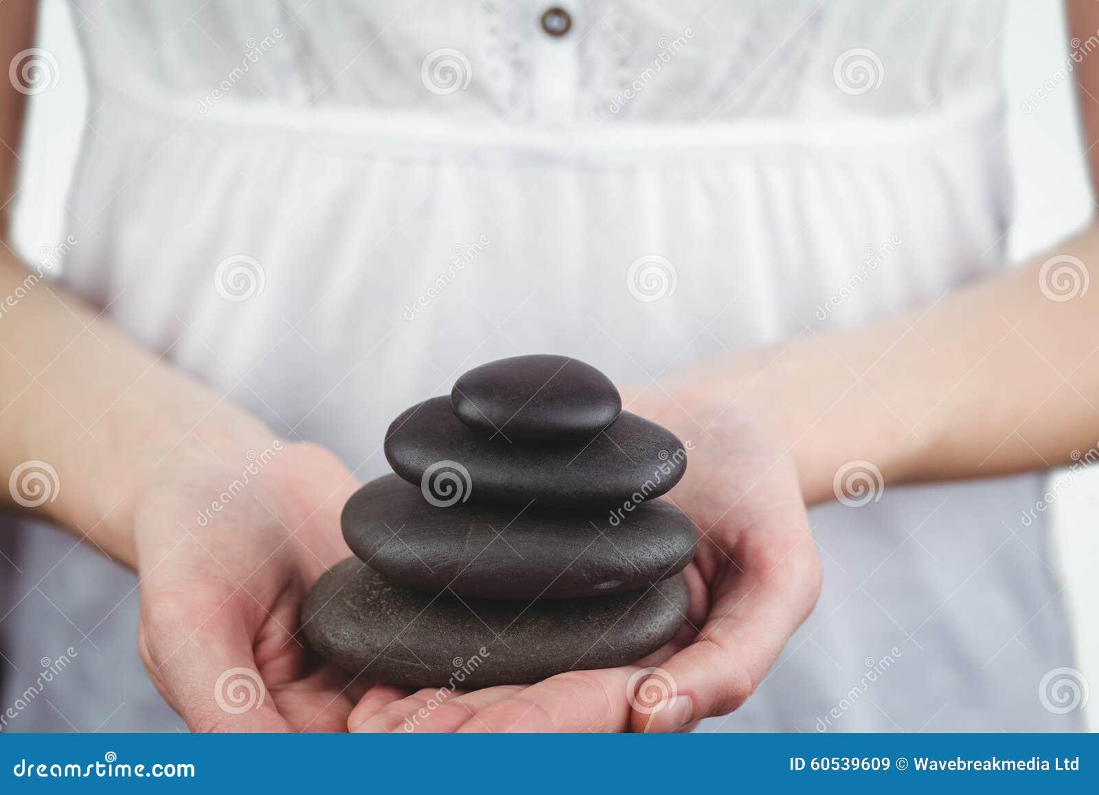 Stenar för kvinnainnehavsvart