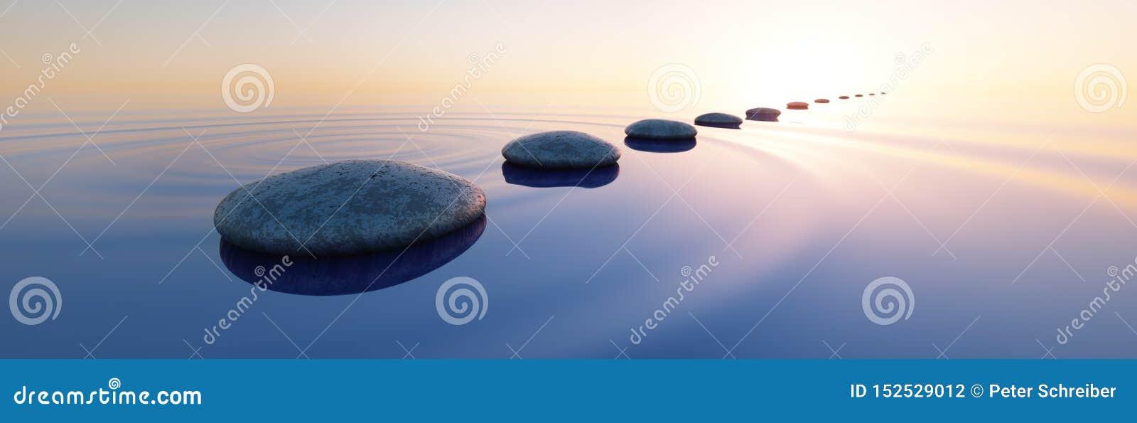 Stenar i ett lugna hav på solnedgången