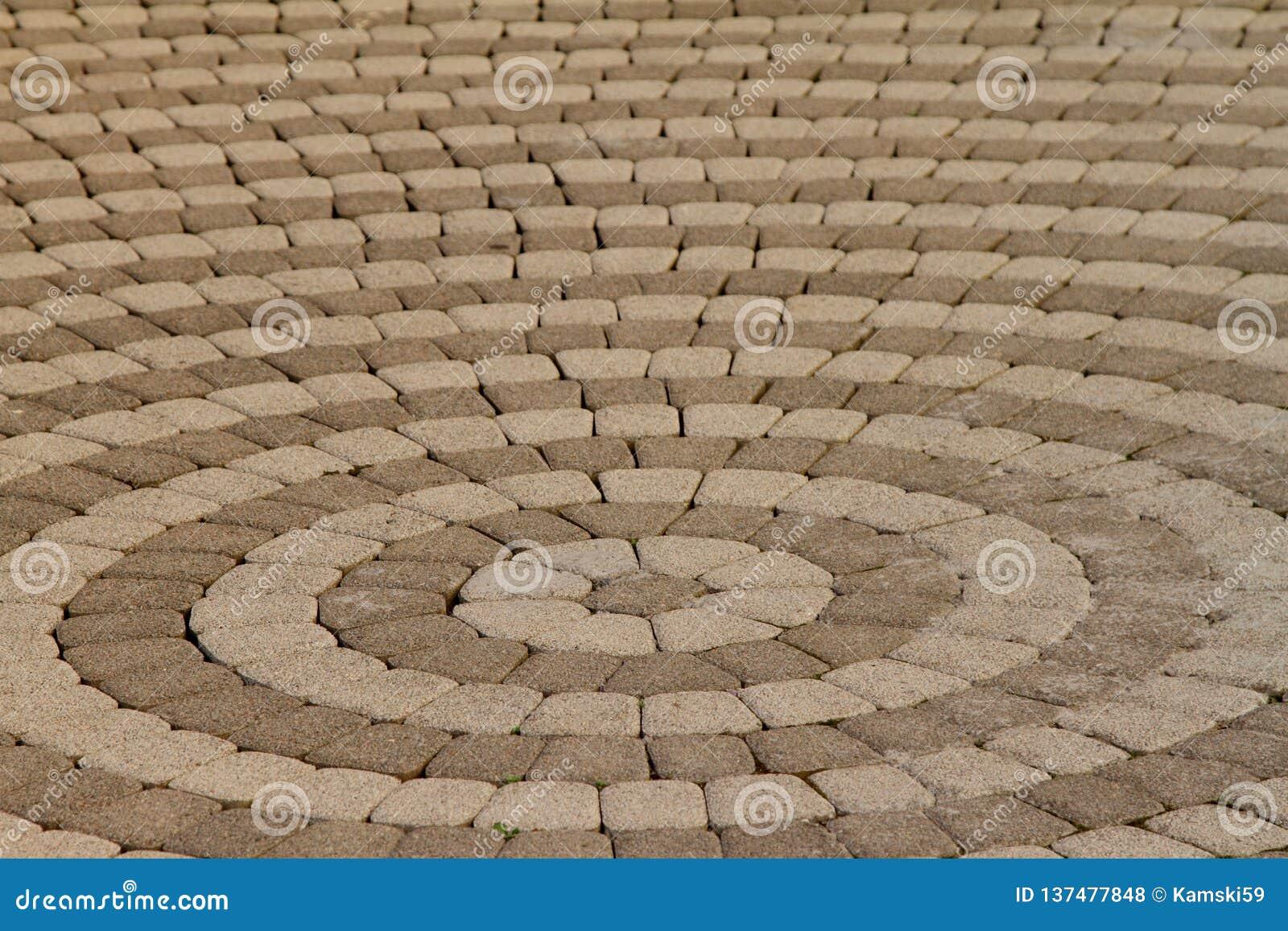 Stenläggningtjock skiva i form av cirklar
