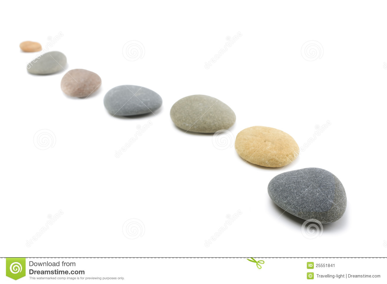 Rounded stones arranged in a curving line on white background.