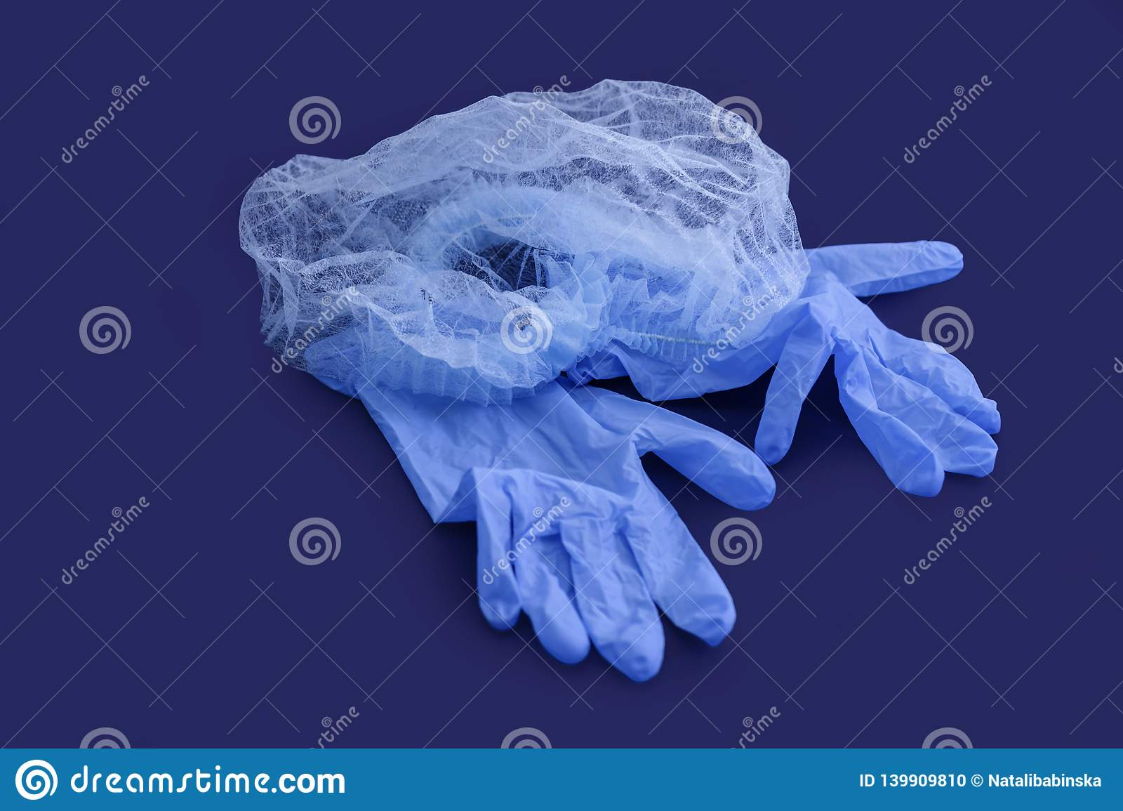 Sterile aseptic surgical glove blue background cap hat top view still life