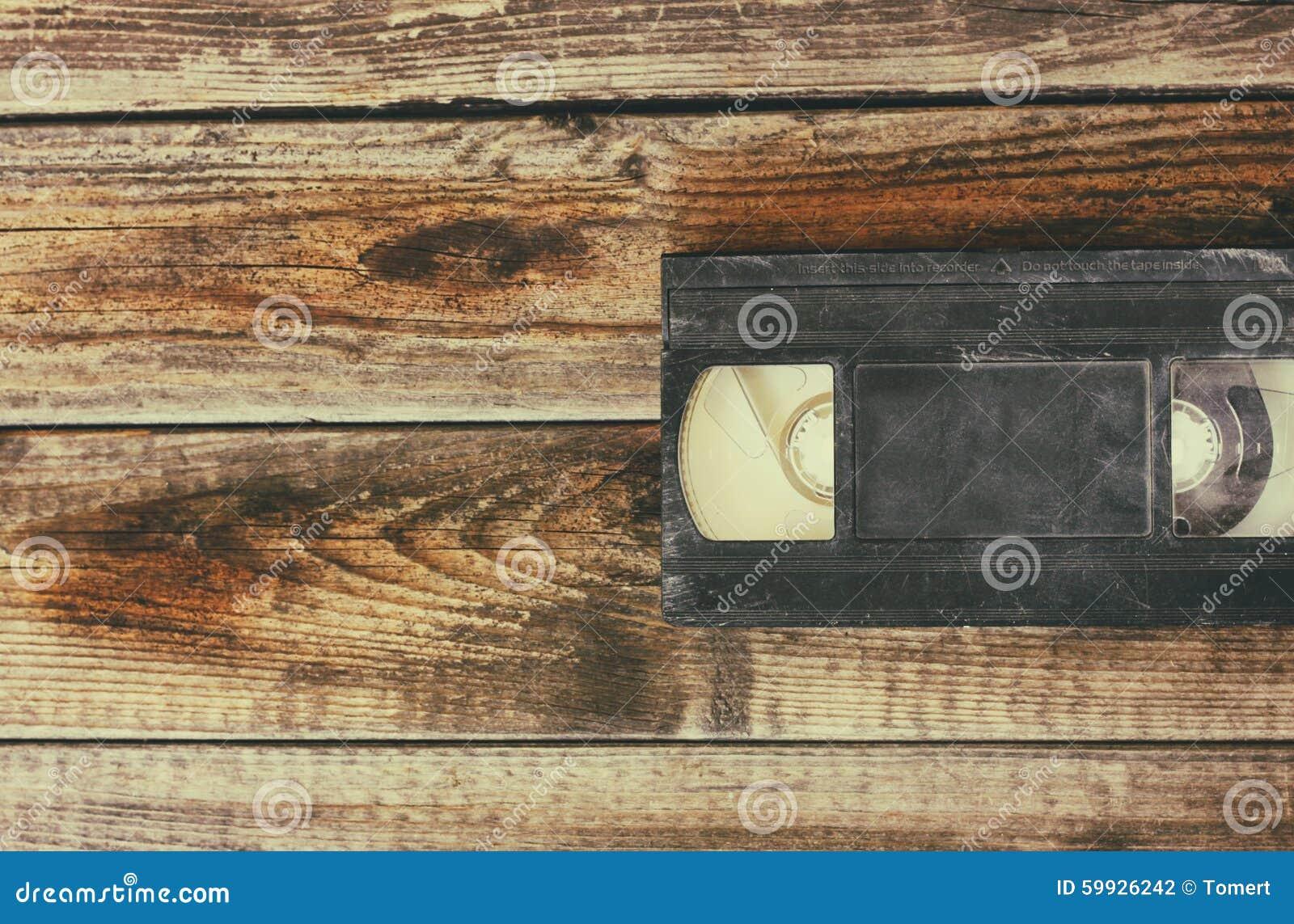 Sterta VHS wideo taśmy kaseta nad drewnianym tłem Odgórnego widoku fotografia