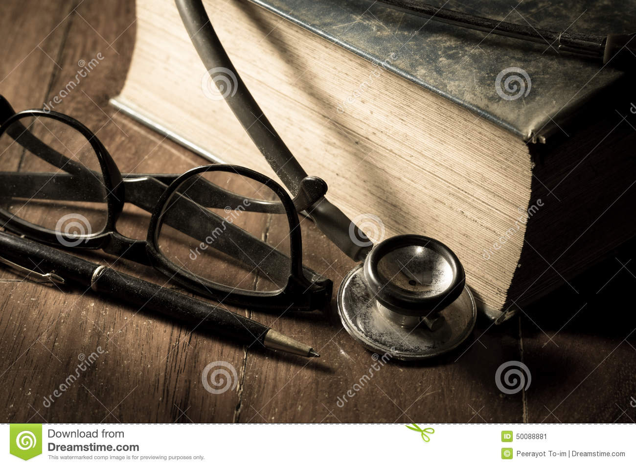 Stethoscope with eyeglasses,pen and book.