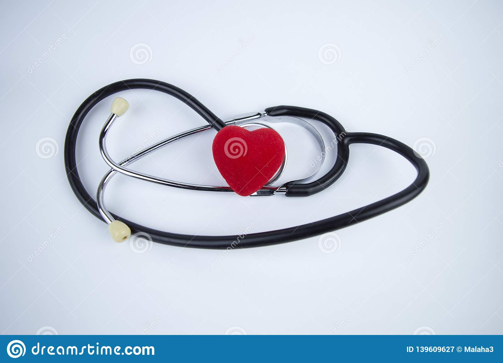Stethoscope with heart on a white background