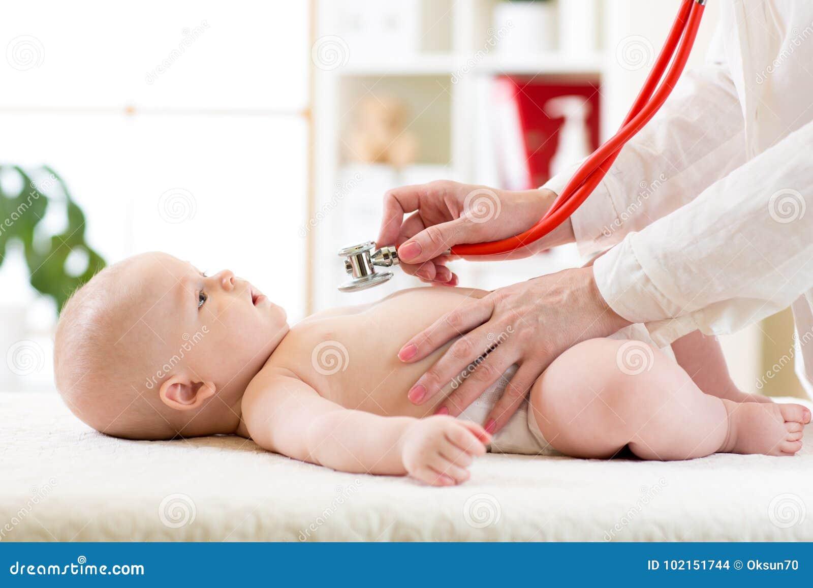 Stethoscope listening to baby`s heart beat