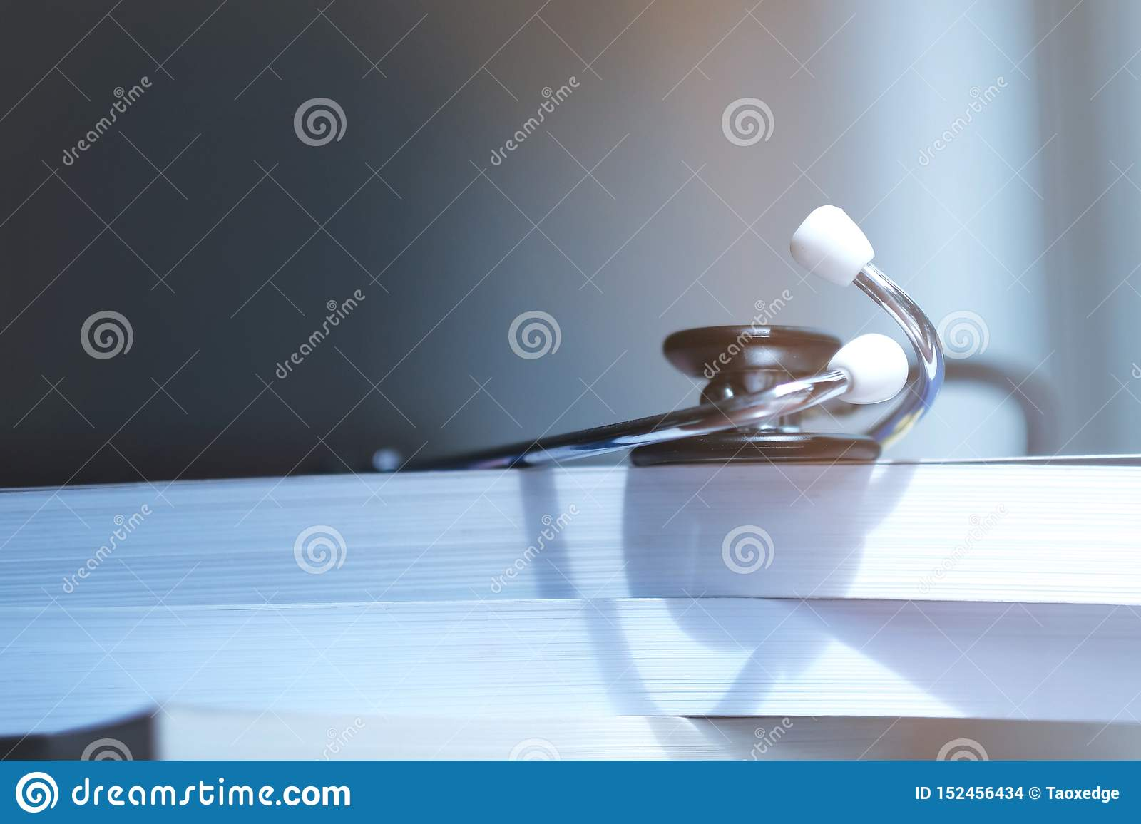 Stethoscope on medical textbooks in library