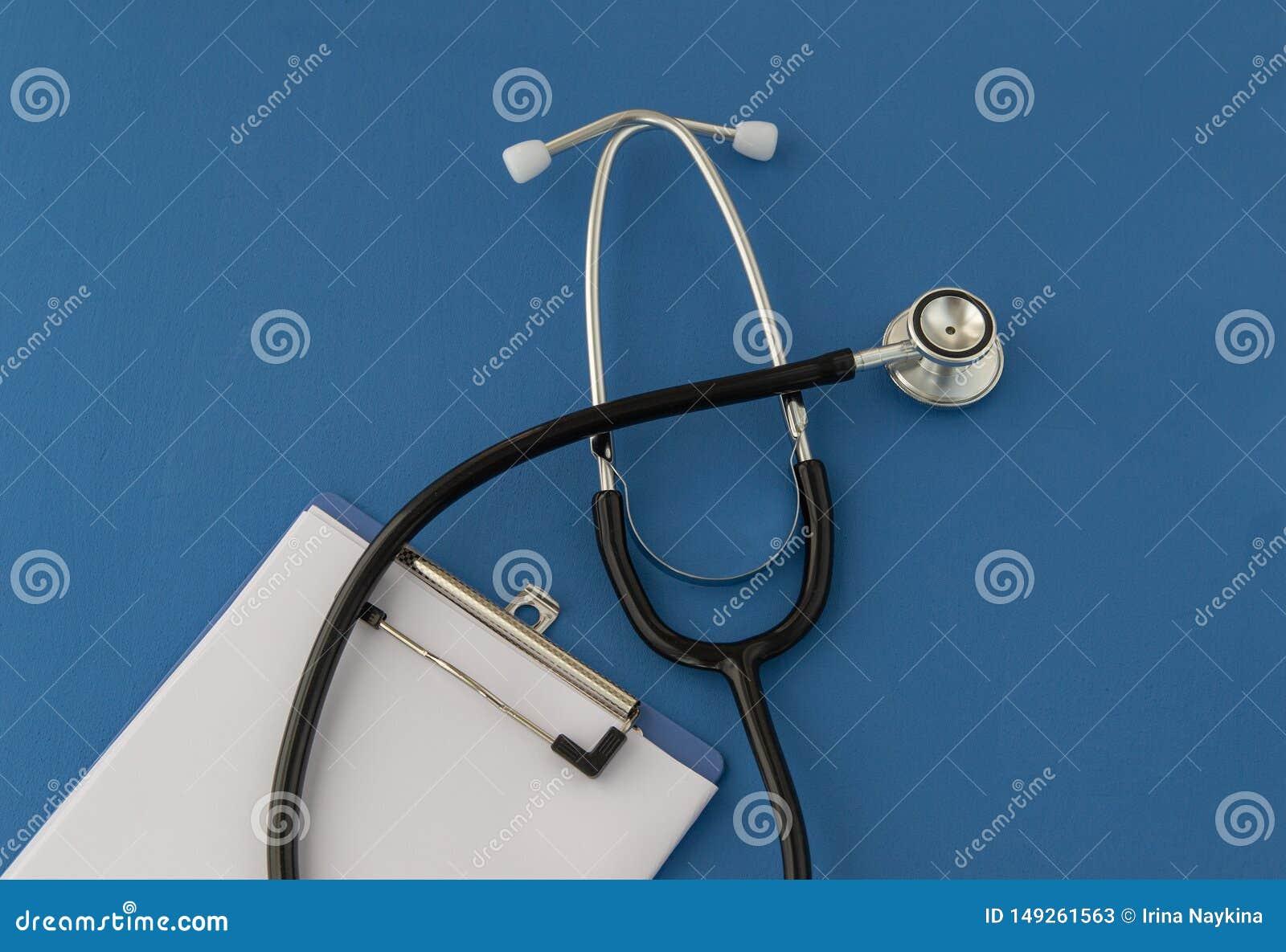Stethoscope, prescription, on blue background. The concept of medicine.