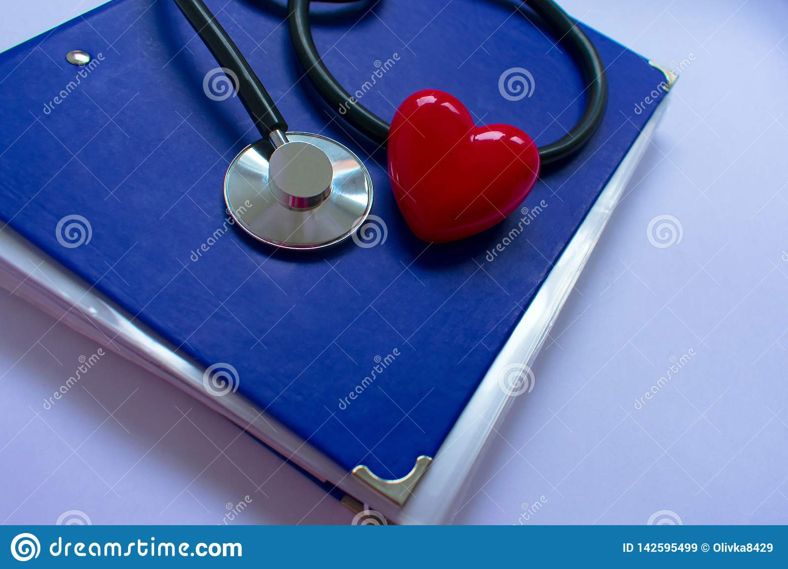 Stethoscope and heartn on black background