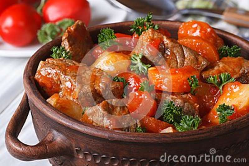 Stew In Tomato Sauce With Vegetables Close Up In A Pot Stock Photo ...