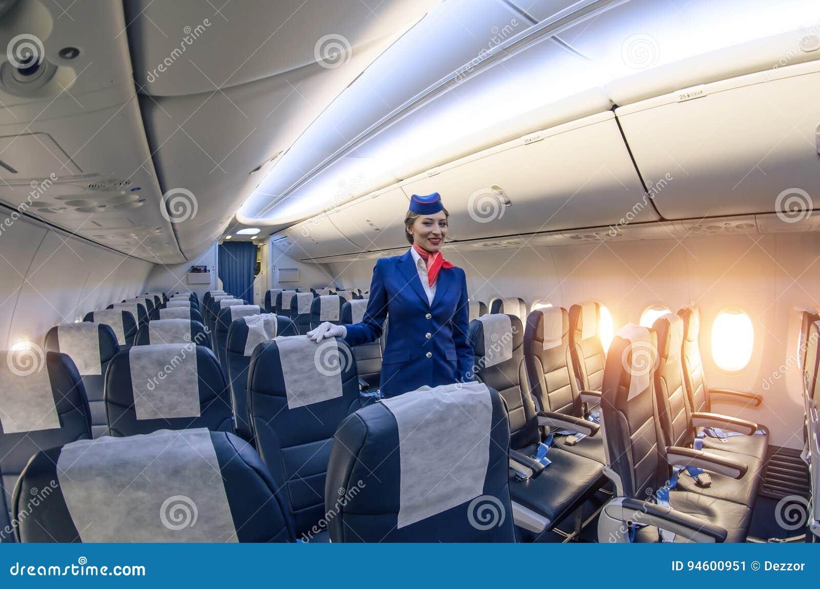 Stewardess and passenger lounge inside the Boeing 737-800. Russia, Saint-Petersburg, November 2016.