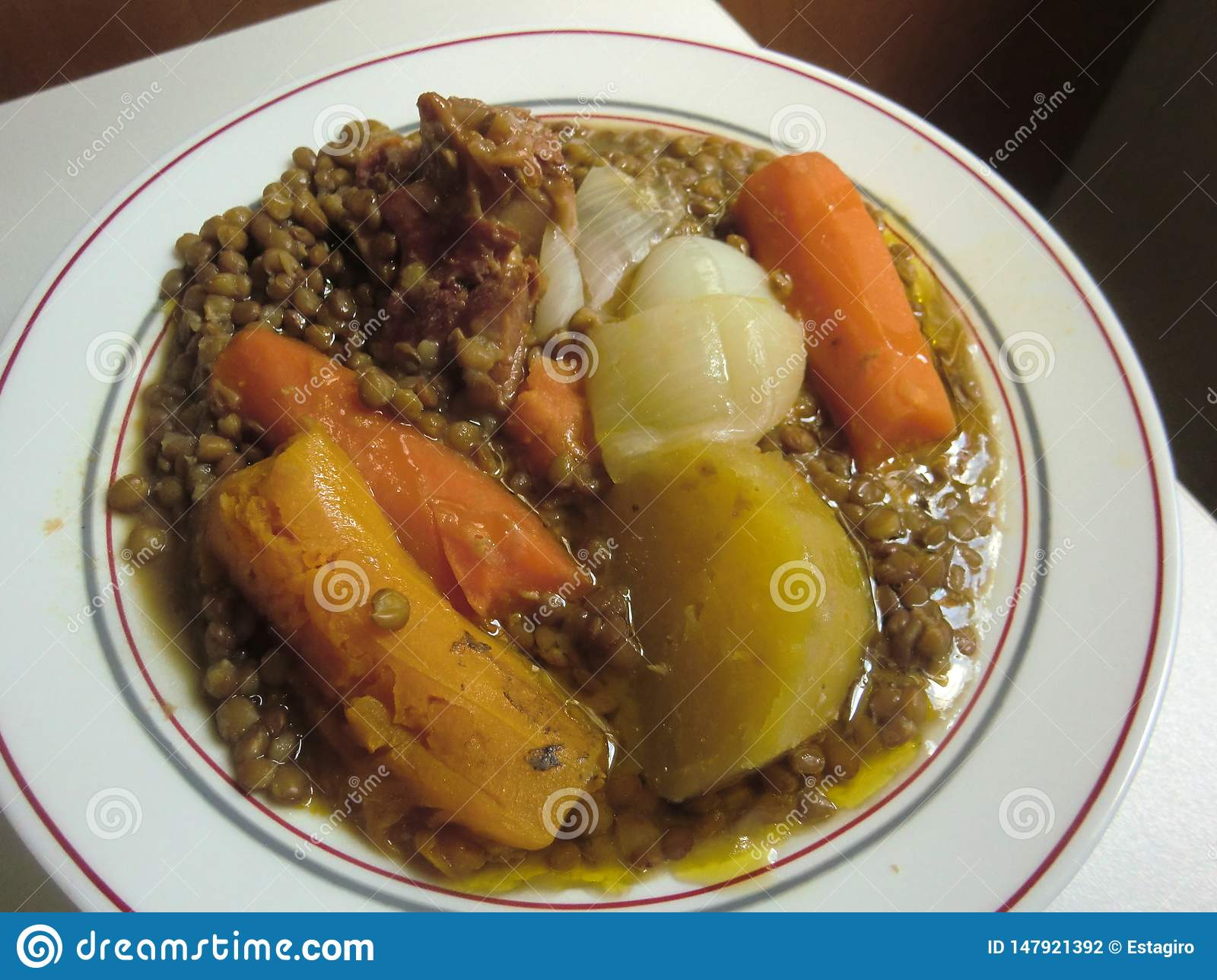 Stewed lentils with pumpkin, carrot, potato and pork meat