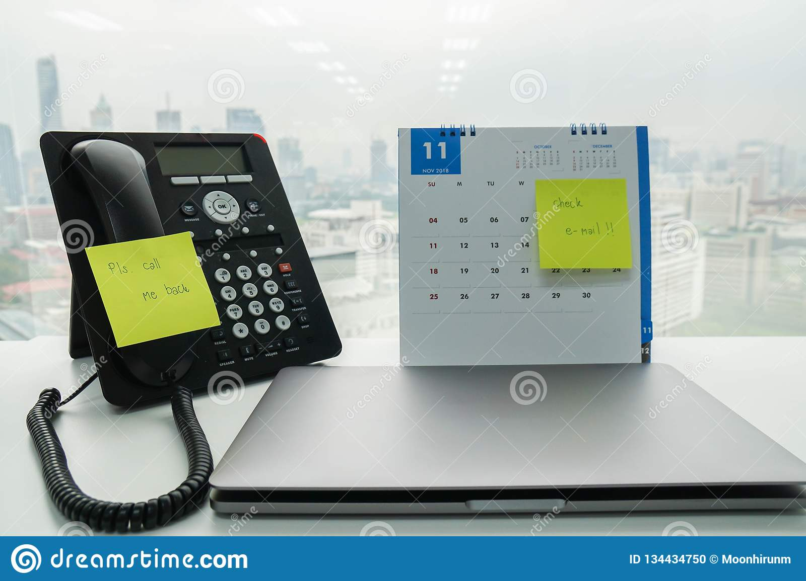 Stick note of call back message and check e-mail on IP phone and November calendar for employee reminder with computer