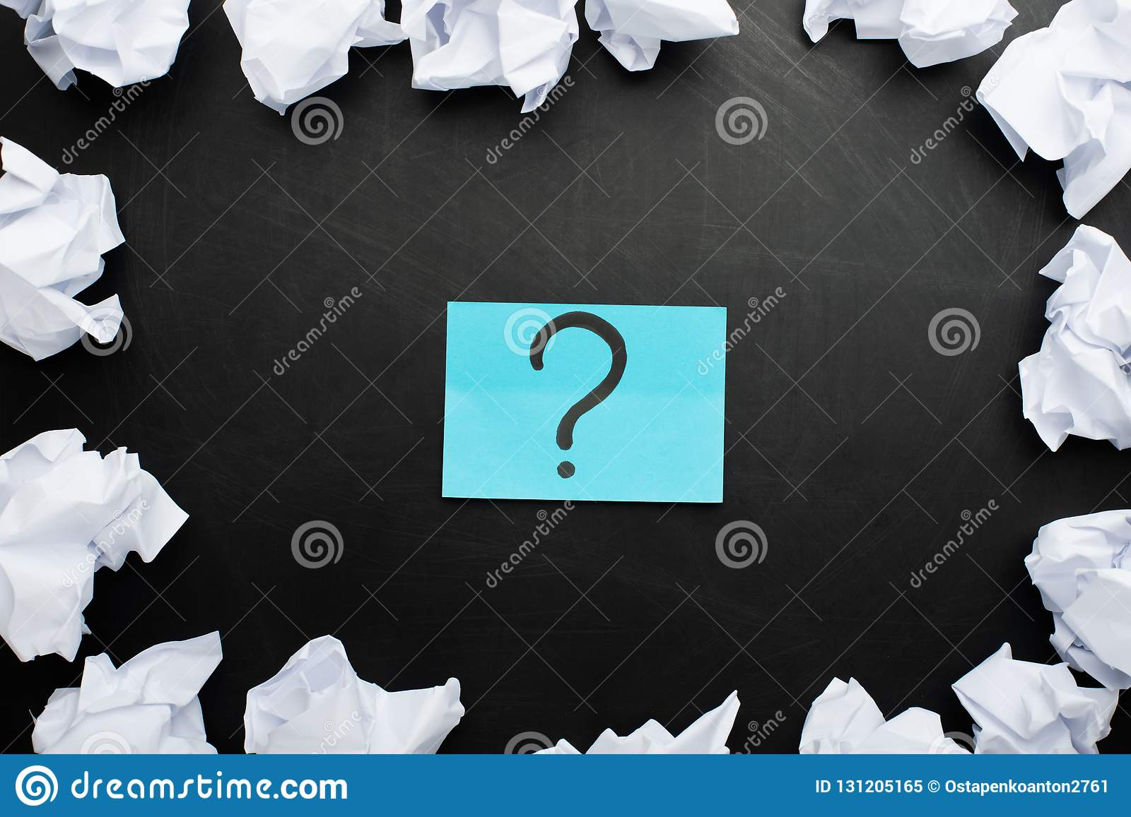 sticker with a question mark and around crumpled paper, concept ideas, torment to ideas