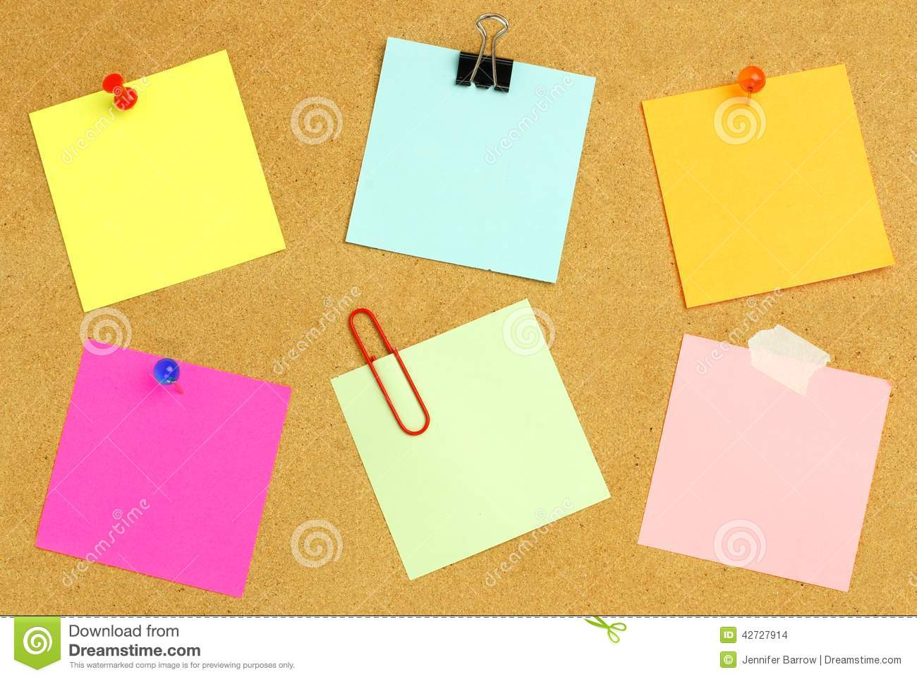 sticky notes on bulletin board stock photo