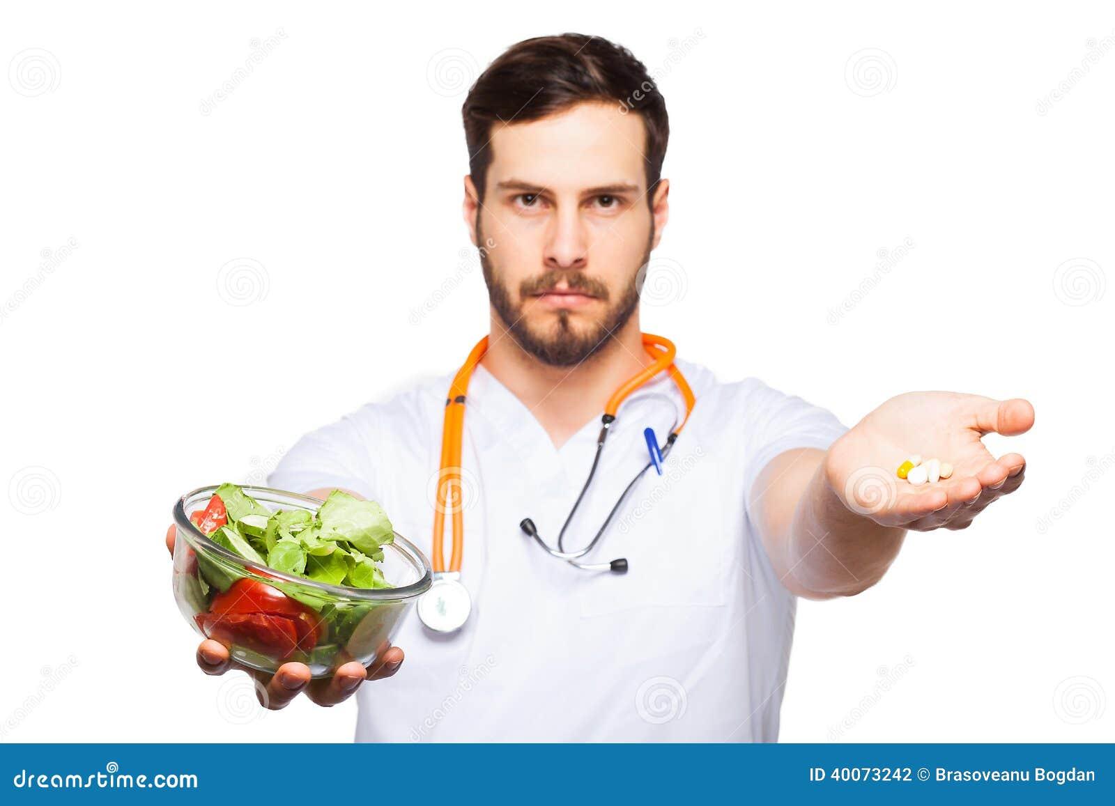 Stilig manlig doktorsvisningsallad och preventivpillerar