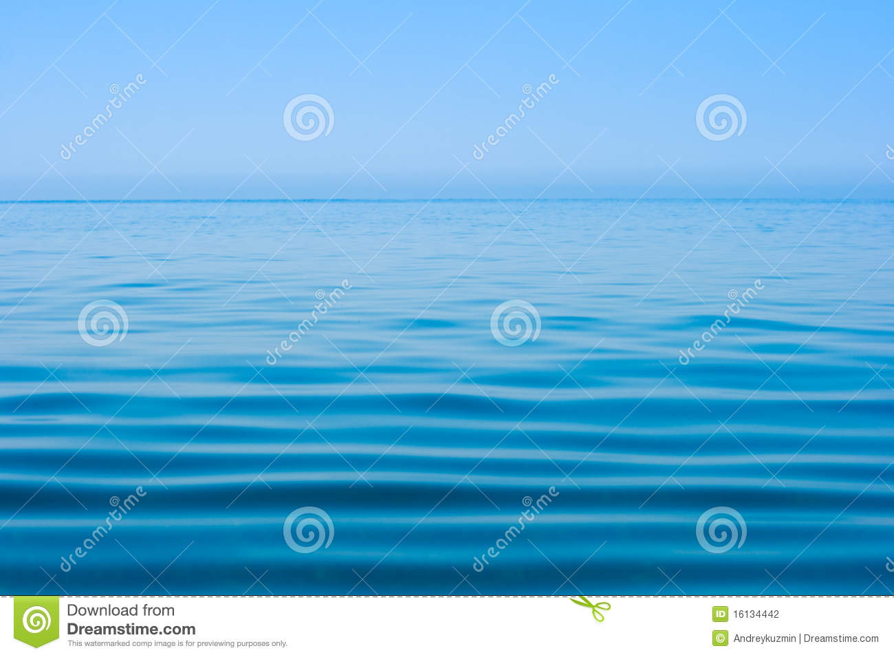 Still calm sea or ocean water surface and horizon