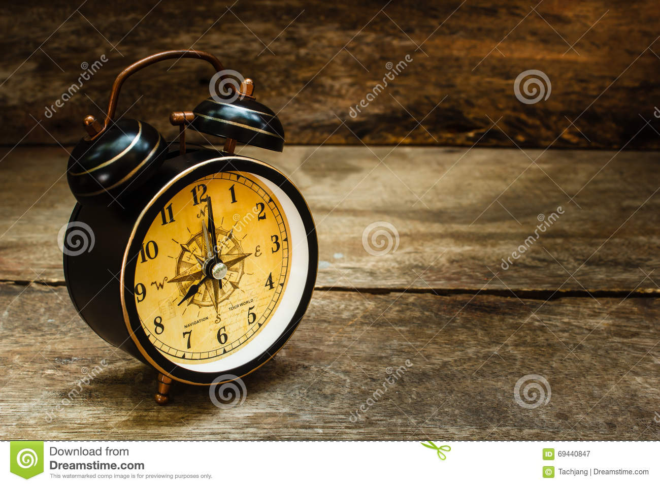 still life with alarm clock on wood table stock image image 69440847. Black Bedroom Furniture Sets. Home Design Ideas