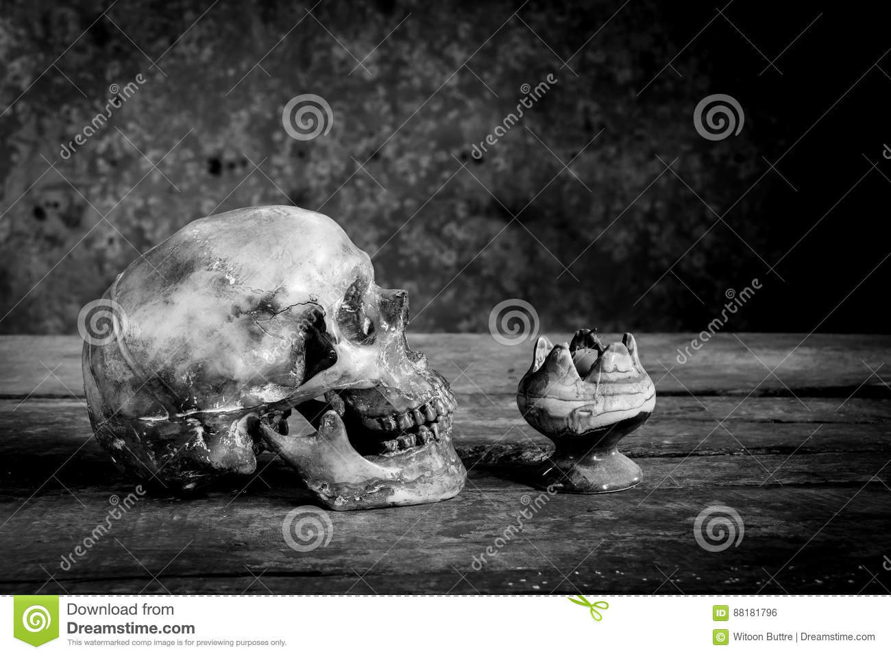 Still life black and white photography with human skulls on wood