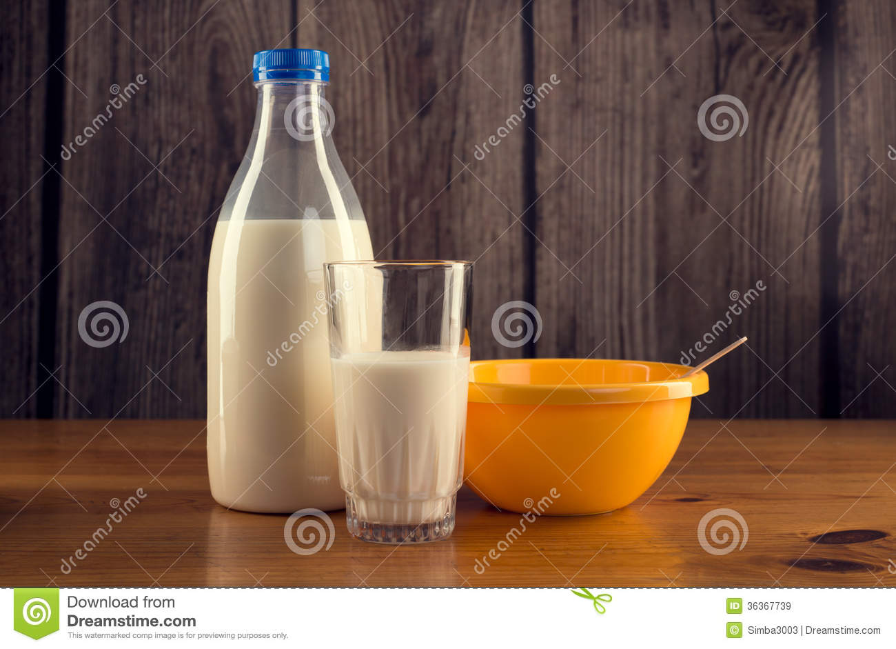 Still Life Of Bottle Of Milk Glass Of Milk And Yellow