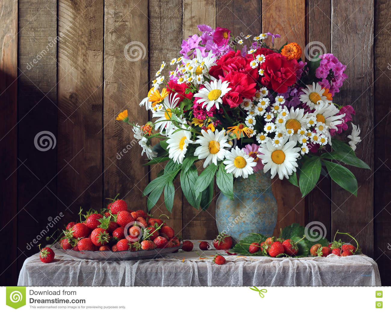 Still Life With A Bouquet Of Garden Flowers And Strawberries Stock